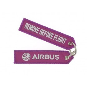 "Fushia ""remove before flight"" key ring"